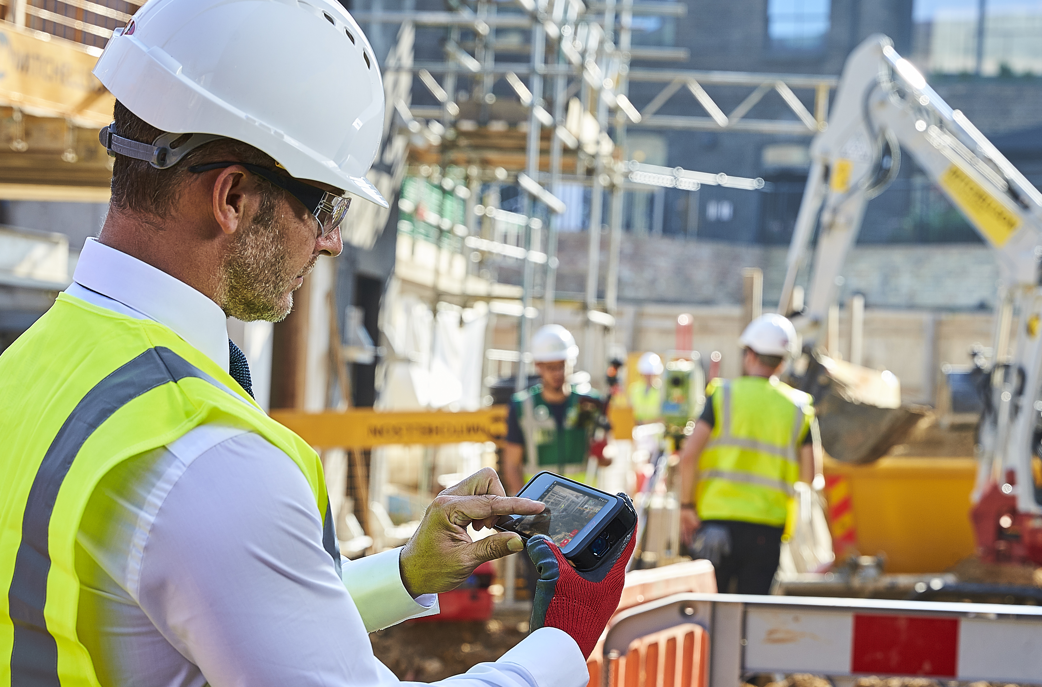 Construction site manager using Leica BLK3D