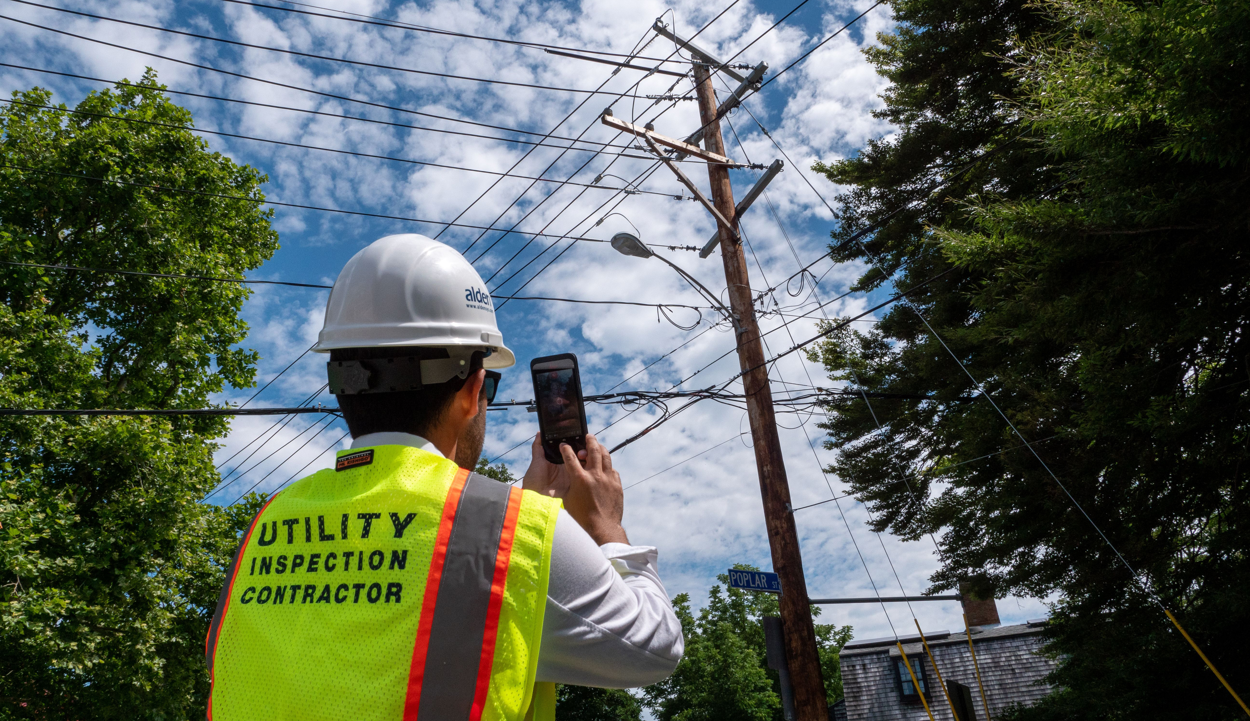 worker measuring utility pole with the BLK3D