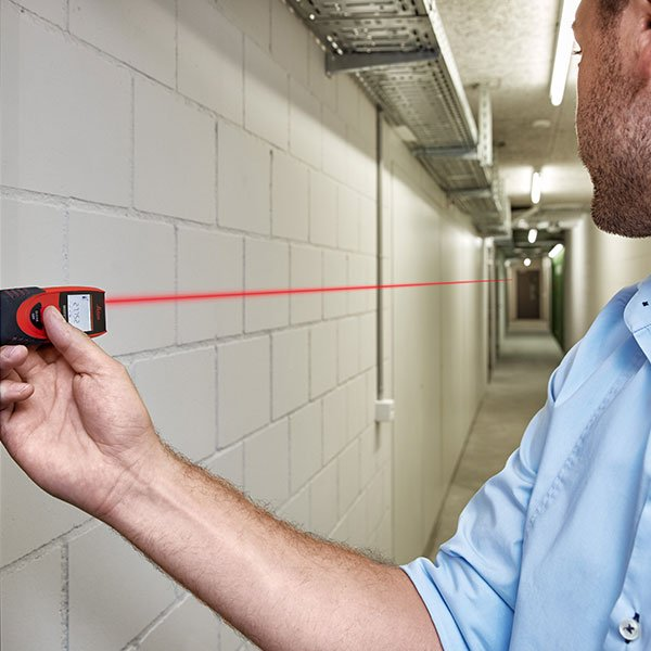 Man using DISTO to measure a hallway