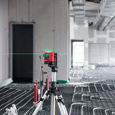 Leica Lino L6G in a wide room, projects lines onto walls and ceiling