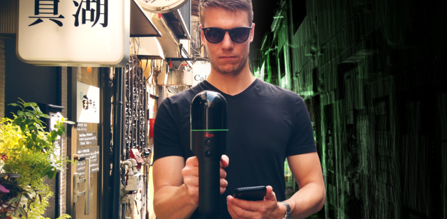 Man scanning an alleyway in Japan with a BLK2GO. To his left is a detailed view of storefronts and to his right is a green and black point cloud of the alleyway