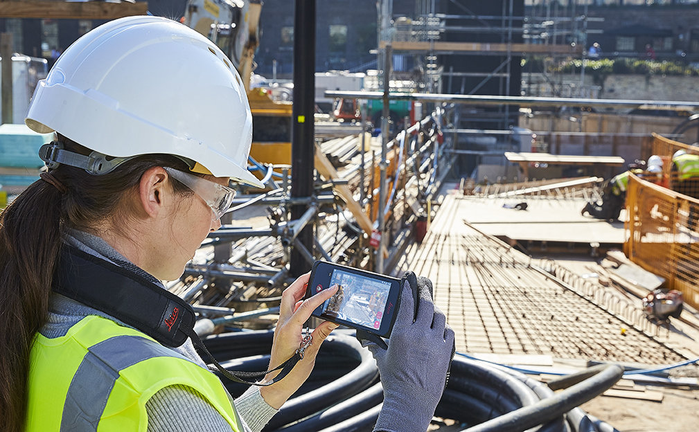Woman using the Leica BLK3D at a construction site