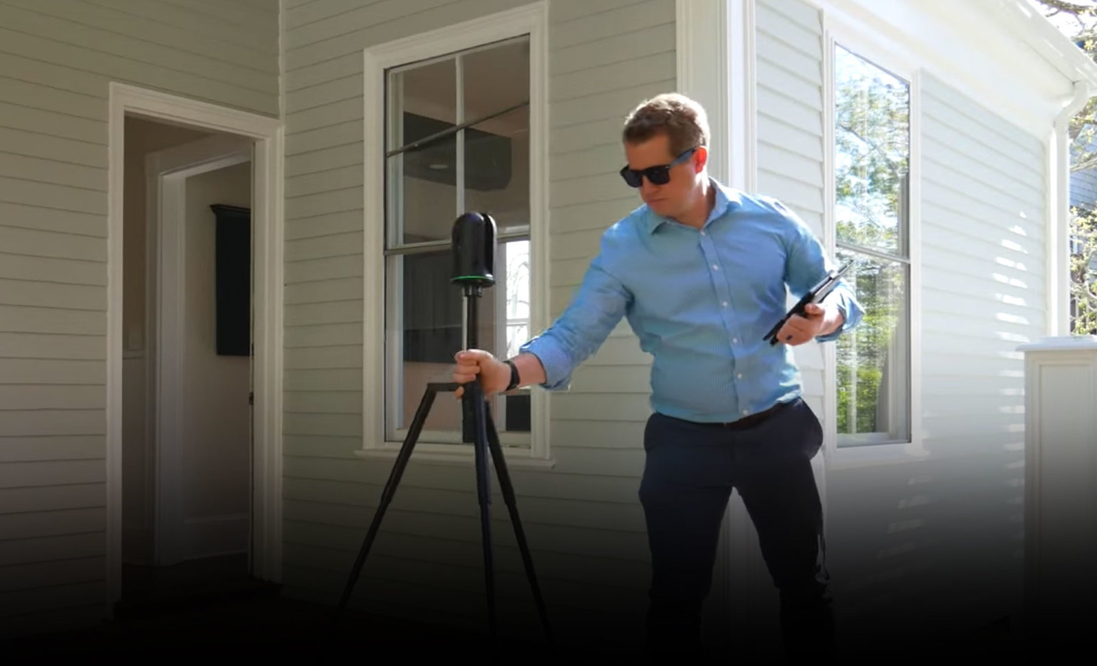 man using BLK360 to scan a house